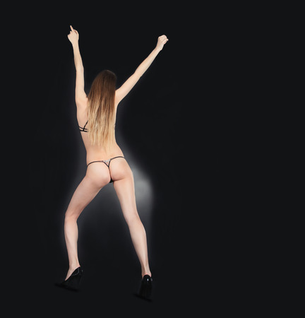 skimpy: Back view skimpy female in the darkness Stock Photo