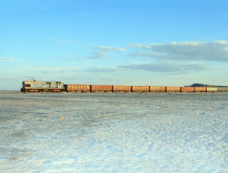 salinity: Russian Federation, Baskunchak - 23 August, 2015: Old rusty train on the salt lake Baskunchak Stock Photo