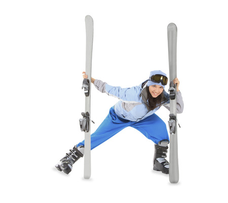sportwear: Young girl in sportwear with ski isolated over white