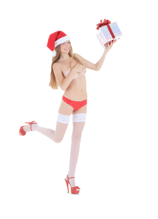 Beautiful nude woman in santa hat with gift box isolated photo