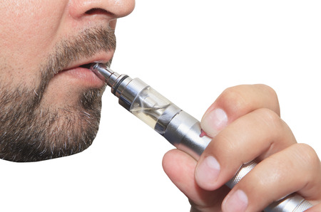 Man smoking electronic sigarette close up Stock Photo
