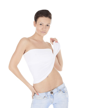 young woman in jeans and blouse posing on white background