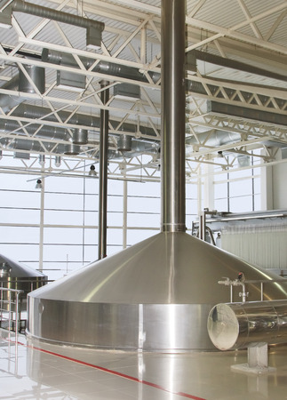 ferment: Moscow, Russian Federation - March 07, 2015: Brewing production - mash vats.