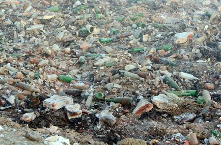 discarded: Large garbage dump waste with broken bottles