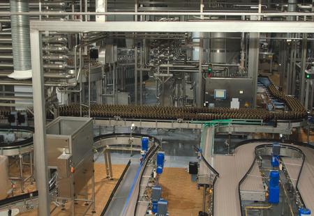 food distribution: Plastic water bottles on conveyor or water bottling machine Stock Photo