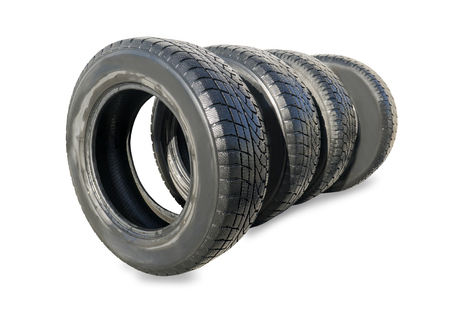 Stack of four wheel new black winter tyres for car Stock Photo