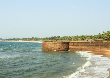 Goa, India - February 26, 2015: Taj Aguada fort near Sinquerium beach at sunny day