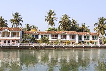 Goa, India - February 24, 2015: White guest house near the river