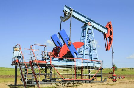 Oil pump are working in the blue sky background Stock Photo