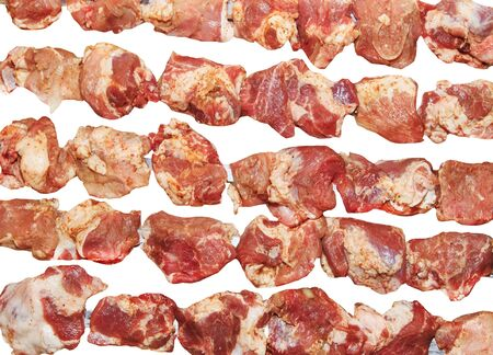Appetizing juicy pickled cuts of meat on skewers ready for grilling shashlik