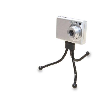 Small digital photo camera on the tripod Imagens