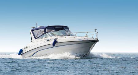 Luxury white speed yacht in open waters