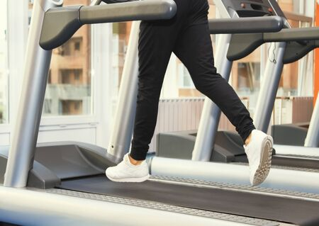 People at the gym exercising. Run on a treadmill