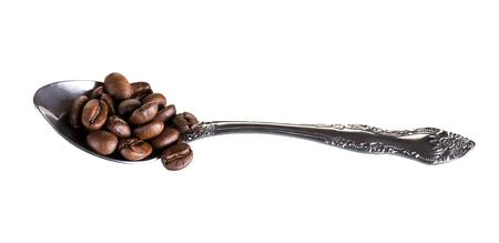granos de cafe: metal, caf�, cereales, cuchara Foto de archivo