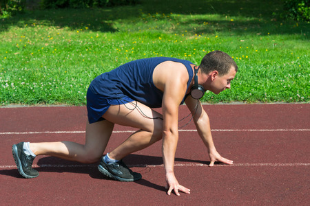 Young athlete on the training track