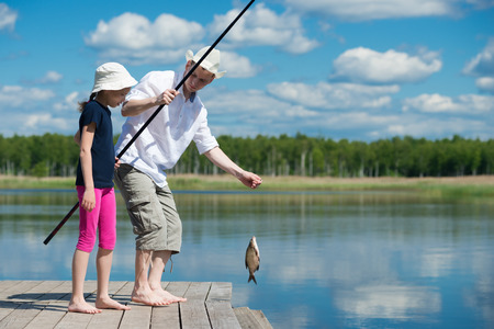 bluegill: Father daughter caught a fish in the river
