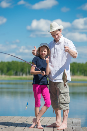 bluegill: Dad and daughter caught fish from the pier on the lake