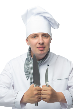 Chef holding two knives in his hands in front of him