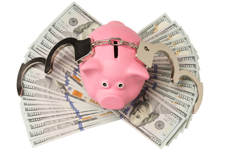 kapilka pig on the money and her handcuffs Stock Photo