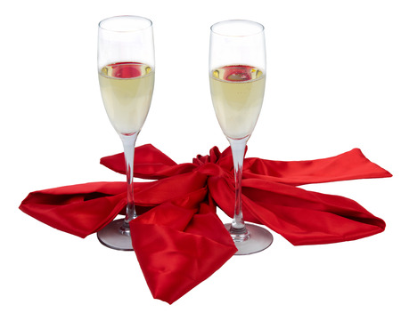 diagonally: two champagne glasses tied with a red bow