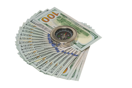 Dollars and compass on a white background Stock Photo