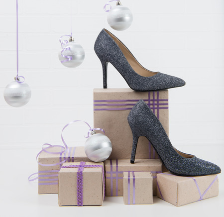 shoes stand on a Christmas shopping on the table Stock Photo