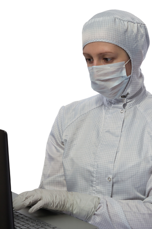 protective: Scientist in protective suit works with a computer on a white background