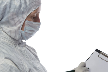 protective suit: woman in a protective suit is writing on paper Stock Photo