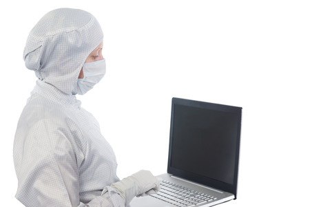 scientist in a suit and mask works with the computer on a white background
