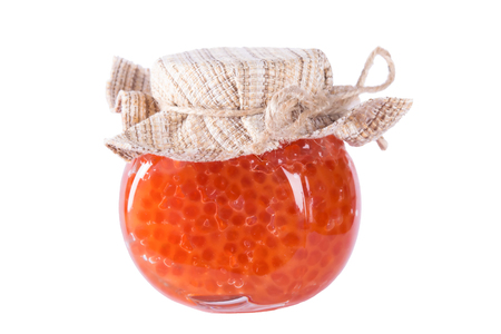 Bank of red caviar on a white background