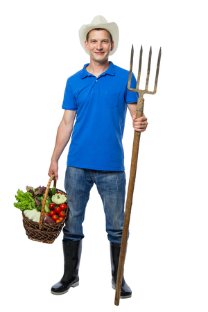 Farmer with forks collected fresh vegetables