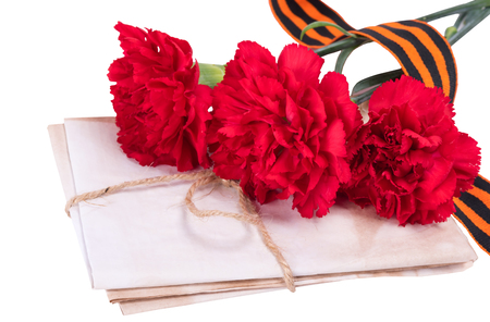 George ribbon with three red carnations bouquet - victory day concept, isolated on white background Stock Photo