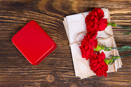 9th: Background for a postcard to the day of victory with carnations and retro papers, and a red box for a medal