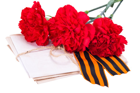 ve: A stack of letters tied with a rope along with red carnations and ribbon to the day of victory, on a white background