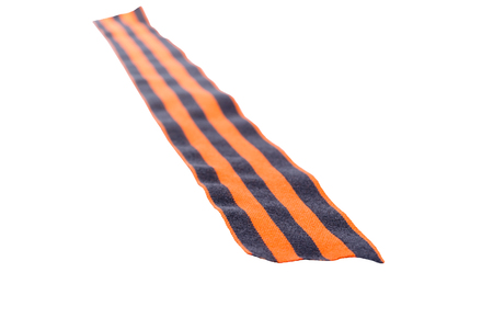 Black orange ribbon on white background leaves into the distance Stock Photo