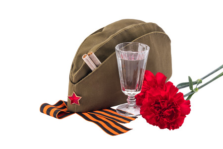 Military cap with red flowers and a star, concept, isolated on white