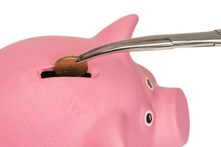 From the piggy bank get coins from above Stock Photo