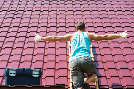 sheathing: The man spread his hands for the inscription on the roof background