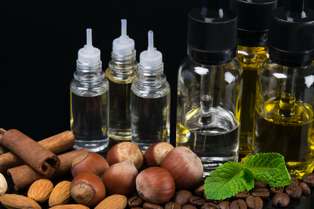 Aromas of nuts and mint mixed in bottles, concept on a black background