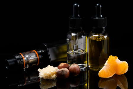 Two flavor liquids with a flavor of waffles with hazelnut and mandarin, in a set for Vaping