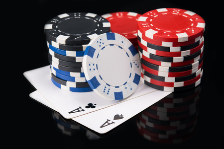 Two aces on a black background, with a big bet of game money