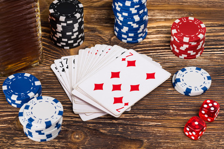 on a wooden table play poker, close-up of chips and poker cards Stock Photo