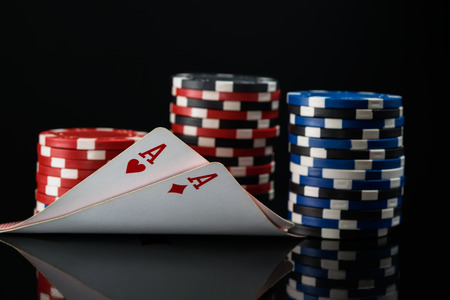 Two red aces in poker cards against the background of poker stakes Stock Photo