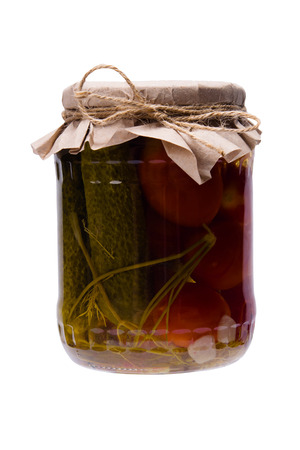 salted cucumbers and tomatoes, in a glass jar closed with a lid