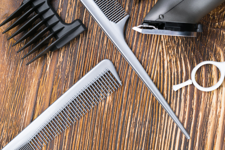 set of tools for mens hair cutting, on a wooden background Stock Photo