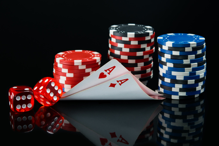 Two aces are reflected in the black background of the table with a big win Stock Photo