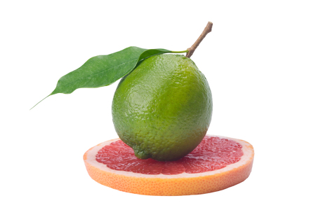 green lime with leaf, on a grapefruit slice, on a white background Stock Photo