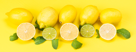 long yellow background with fruit lemons, and mint leaves Stock Photo