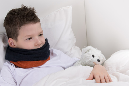 baby boy in bed, with a sore throat, recovers