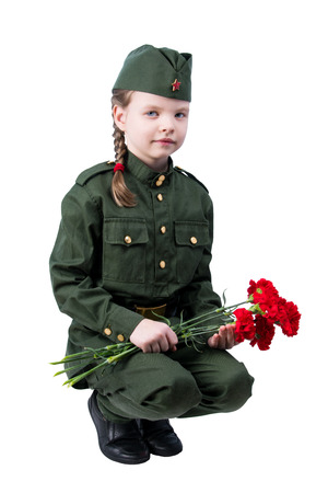 baby girl sitting in uniform with red flowers, on white background